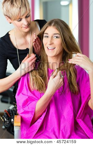 Woman at the hairdresser getting advise on her hair styling