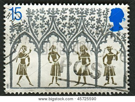 UK - CIRCA 1989: A stamp printed in UK shows image of the 14th-century Peasants from stained-glass window. 800th Anniversary of Ely Cathedral , circa 1989.