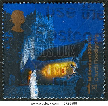 UK - CIRCA 2000: A stamp printed in UK shows image of the Floodlit Church of St.Peter and St. Paul, Overstowey (Church Floodlighting Trust), circa 2000.