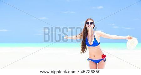 young long-haired woman in bikini enjoying her vacation