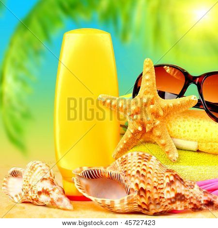 Closeup still life of beach accessories on sea shore, relaxation outdoors at luxury tropical resort, day spa, suntan and sunglasses, summertime holidays