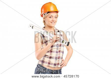 Smiling female worker with helmet holding a construction bubble level isolated on white background