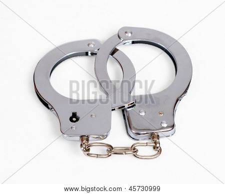 A pair of handcuffs isolated over white with clipping path