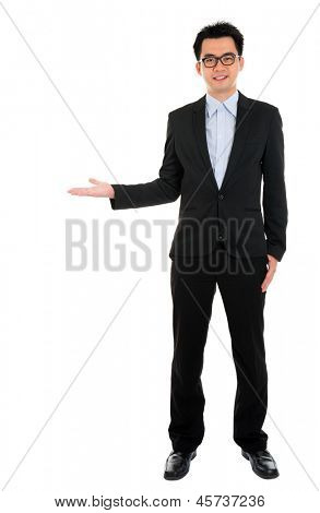 Full body portrait of young happy smiling cheerful Asian business man hand showing blank copy space, isolated over white background