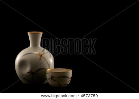 Sake Bottle And Cups On Black