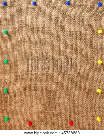 Burlap Background With The Pins As A Frame