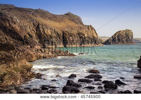 Kynance Cove beach with people on rocks