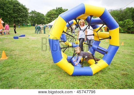 MOSCOW - AUGUST 18: Child crawls in large inflatable wheels at festival Ekofest 2012 on banks of Stroginsky gulf, on August 18, 2012 in Moscow, Russia.