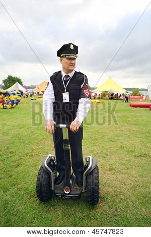 MOSCOW - AUGUST 18: Security guard on Segway at festival Ekofest 2012 on banks of Stroginsky gulf, on August 18, 2012 in Moscow, Russia.