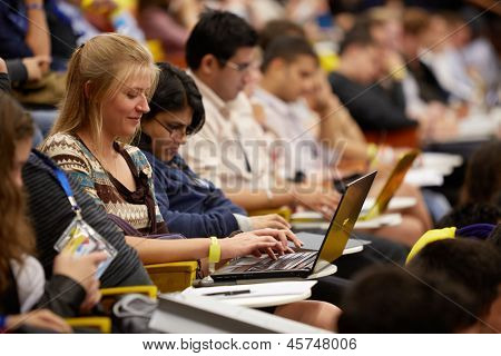 MOSCOW - AUG 20: Young girl participant of  Global Youth to Business Forum works on laptop in congress-hall of Moscow School of Management in Skolkovo, August 20, 2012, Moscow, Russia.