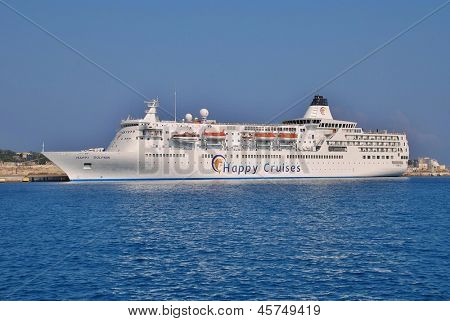 RHODES, GREECE - JUNE 16: Cruise ship Happy Dolphin moored in Akantia harbour on June 16, 2011 on the Greek island of Rhodes. The 174 metre ship was built in 1990 in Japan.