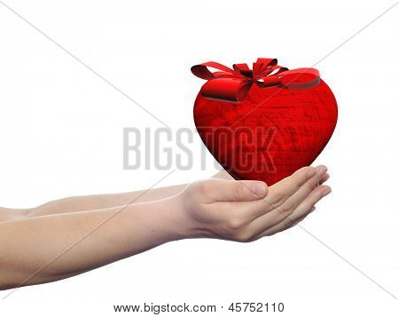 Conceptual 3D heart with a ribbon held in human or woman hands as gift or present isolated on white background