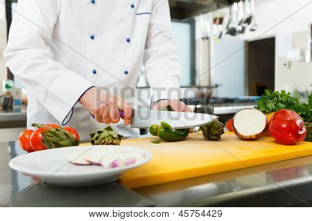 Chef preparing vegetables in his kitchen