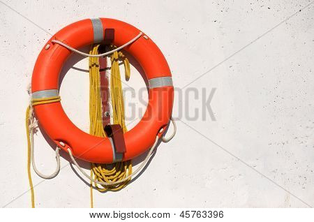 Life Preserver On White Concrete Background