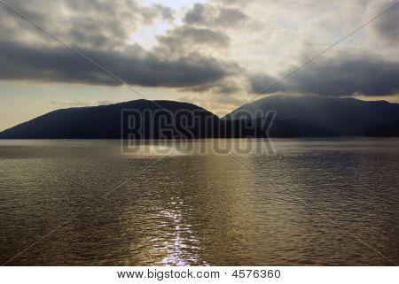 Sun Rays Through Clouds Above Islands In Howe Sound Vancouver