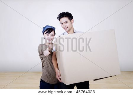 Asian Couple Bring Box To New House