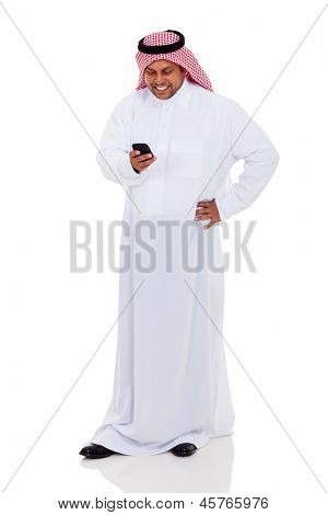 cheerful arab man  reading email on smart phone isolated on white
