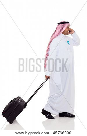 arabian business traveler talking on cell phone isolated on white