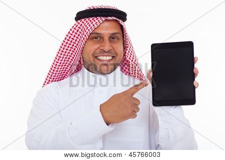 portrait of cheerful muslim pointing tablet computer on white background