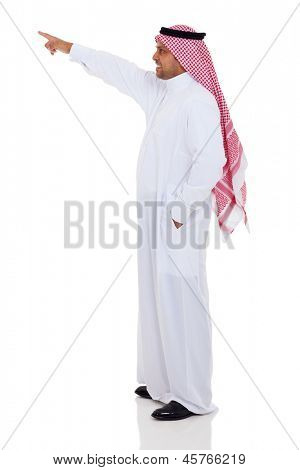 side view of arabian man pointing up, isolated on white