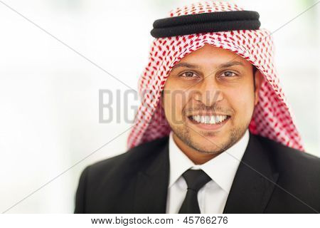 smiling arabian corporate executive portrait in black suit