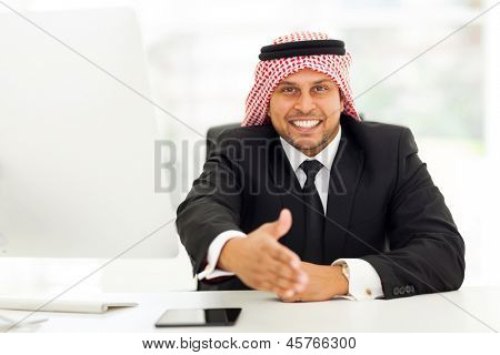 friendly arabic businessman giving handshake gesture