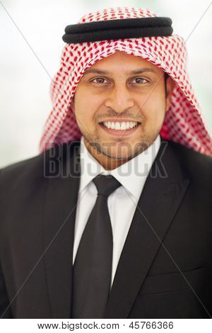 close up portrait of islamic man in black suit