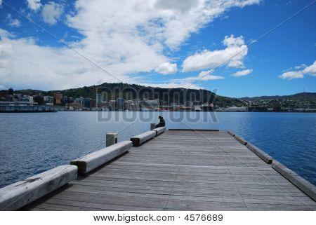 Man sitting at port