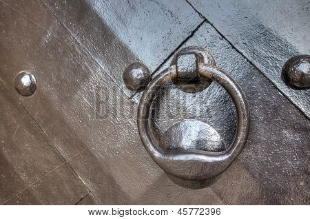 A Strong Wooden Door With Heavy Rivets