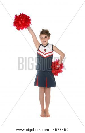 Young Girl In Cheerleader Outfit And Ponpons