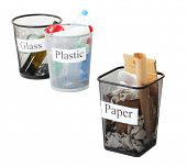 Three buckets of assorted debris isolated on white