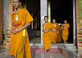 PHUKET, THAILAND - MAY 2: Young unidentified Buddhist monks in the temple Chalong on may 2, 2013 in