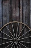 image of wagon wheel  - wagon wheel against wood - JPG