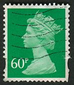 UK-CIRCA 2010: A stamp printed in UK shows image of Elizabeth II is the constitutional monarch of 16