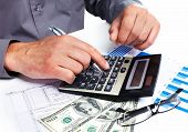 stock photo of accountability  - Hand with a calculator - JPG