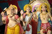 picture of saraswati  - Hindu deities of ganesha hanuman and saraswati at a temple in India