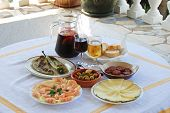 pic of nibbling  - A selection of tapas with sangria and beer Fried green peppers olive cocktail Chorizo slices Sliced Manchego cheese Prawns Costa del Sol Malaga Province Andalucia Spain Western Europe - JPG