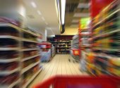 foto of clientele  - Fast shopping with cart in a large supermarket - JPG