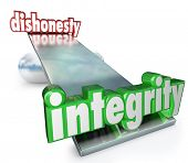 stock photo of corrupt  - The words Integrity and Dishonesty on scale - JPG
