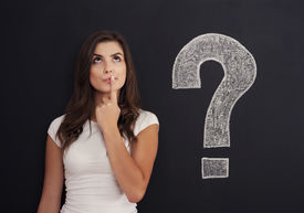 stock photo of punctuation marks  - Young woman with question mark on blackboard - JPG