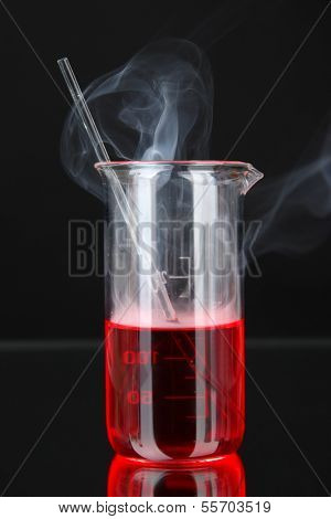 Laboratory beaker on black background