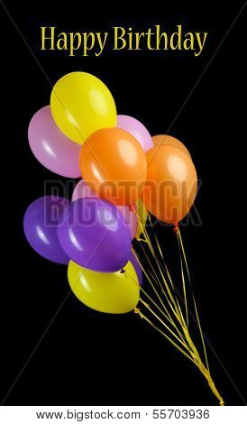 Colorful balloons isolated on black