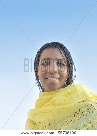 Beautiful African woman wearing a traditional scarf