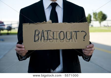 Businessman Holding A Sign That Says Bailout?