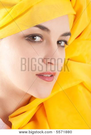 Woman Covering In Yellow Cloth