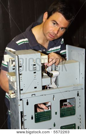 Picture Of Male Working On Fixing A Server Computer