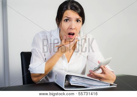 Businesswoman Looking In Shock After Calculating