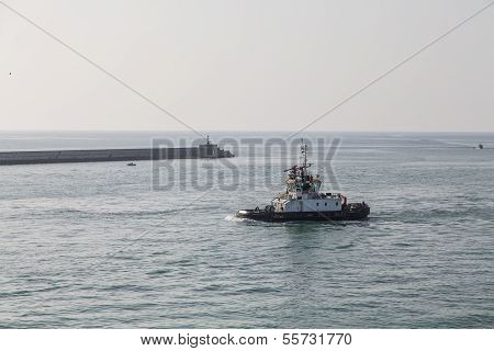 Tugboat By Sea Wall