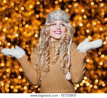 Fashionable lady  wearing cap and muffler coat outdoor. Portrait of young beautiful woman in winter