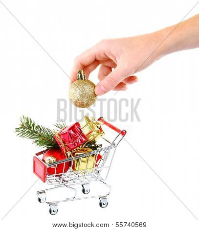 Hand and Christmas gifts in shopping trolley, isolated on white